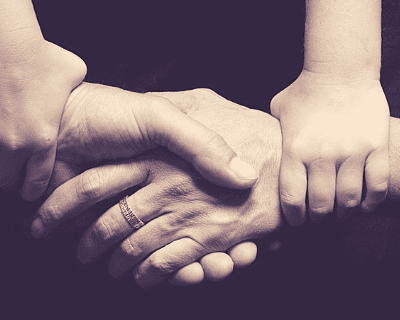 hands of child and parent